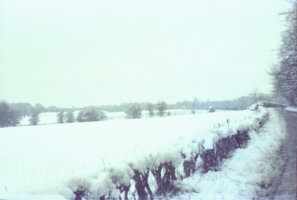 Snow covered fields along lane to Pilgrims Holt
